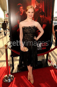 """""""True Blood"""" star Deborah Ann Woll wears a black pleated gazaar A-line dress with floral embroidered lace and tulle bodice from the Tadashi Shoji Fall 2011 Runway Collection to the premiere of Season 4 at ArcLight Cinemas Cinerama Dome on June 21, 2011. Woll accessorizes with Swarovski's gold crystal Fantasy bracelet."""