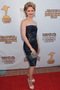Actress Whitney Able carries an M.C.L. by Matthew Campbell Laurenza Gold Crest Collection Stingray clutch to the 37th Annual Saturn Awards at The Castaway in Burbank on June 23, 2011.