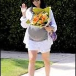 Actress Selma Blair wears a pair of under belly cuffed maternity shorts and a striped short sleeve scoop neck dolman sleeve maternity T-shirt from A Pea in the Pod Collection on her birthday in Santa Monica on June 23, 2011.