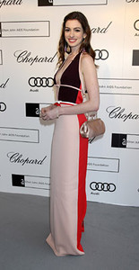 Actress Anne Hathaway wears Chopard pink  drop sapphire briolette earrings and a  white, yellow and pink diamond line  bracelet to Elton John's White Tie and  Tiara ball in London on June 23, 2011.