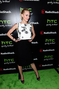 Actress Jamie King wears M.C.L. By Matthew Campbell Laurenza black sapphire earrings with white enamel and black sapphire crown bangles to Radioshack's HTC EVO 3D launch party on June 23, 2011 in West Hollywood.