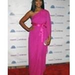 Hostess Garcelle Beauvais wears a Jay Godfrey ELISSA hot pink silk chiffon kimono sleeve one-shoulder gown at the March of Dimes Health Baby Healthy Future dinner on June 24, 2011. Beauvais accessorizes with Swarovski's blush pink Power clutch and a hot pink and clear Geranium crystal ring by Daniel Swarovski.