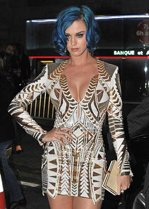 Singer Katy Perry wears Diamond in the Rough 18K white gold and rough diamond drop earrings and a Diamond in the Rough 18K white gold and diamond iceberg ring in Paris on March 1, 2012.