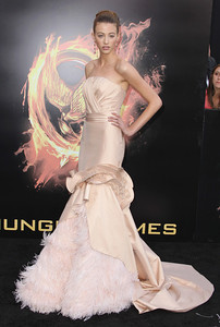 """Actress Kalia Prescott wears a Cengiz Abazoglu couture gown from the Spring 2012 collection and Tresor 18K rose gold morganite and diamond earrings to the premiere of her film """"The Hunger Games"""" at Nokia Theatre L.A. Live on March 12, 2012."""