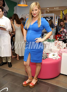 Actress Jessica Capshaw wears a Diane von Furstenberg Saturn dress at the premiere of GapKids + DVF Collection at the Grove on March 3, 2012.