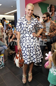 Actress Busy Phillips wears a Diane von Furstenberg Raven dress at the premiere of GapKids + DVF Collection at the Grove on March 3, 2012.