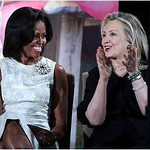 Michelle Obama, with Hillary Rodham Clinton, wears a Miriam Haskell statement broach of glass beads and pearls at the State Department's 2012 International Women of Courage Awards on March 8.