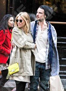Actress Sienna Miller, with beau Tom Sturridge, carries a Diane von Furstenberg Mini Harper handbag in neon yellow shopping in New York City.