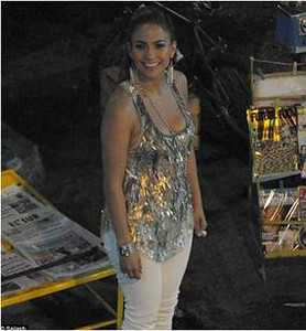 """Jennifer Lopez wears Jenny Packham's charcoal and silver paillette sequin racer back tank from the Fall/Winter 2011 collection on the set of her new music video, """"Follow the Leader,"""" in Mexico."""