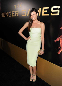 """Actress Odette Annable-Yustman wears Amrapali 14K gold and diamond kite-shaped earrings and Amrapali bangles in gold and silver stone with diamonds, 18K gold and diamond and 14K gold and pave diamond to the premiere of """"The Hunger Games"""" at Nokia Theatre L.A. Live on March 12, 2012."""
