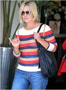 Jennie Garth wears a Jia Collection Reversible Elena pullover striped sweater in Beverly Hills.