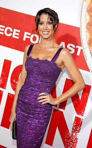 """Actress Shannon Elizabeth wears Sethi Couture 18K dare opaque diamond drop earrings with white diamond border and a Sutra 18K brown rose-cut diamond ring to the premiere of """"American Reunion"""" at Grauman's Chinese Theatre on March 19, 2012."""