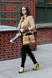 Actress Michelle Trachtenberg wears a camel colored Bastille military-style jacket by Bec & Bridge in New York City.