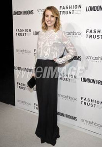 Actress Emma Roberts carries Swarovski's black satin Party Time clutch at the British Fashion Council's London Show Rooms LA party in West Hollywood on March 12, 2012.