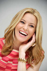"""Actress Elizabeth Banks wears an Adeler one-of-a-kind 14K yellow gold ring with angel skin coral cabochon at """"The Hunger Games"""" press conference at the Four Seasons Hotel in Beverly Hills on March 1, 2012."""