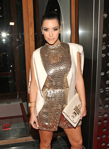 Kim Kardashian wears an Isharya single wire cuff in white agate druzy to Vikram Chatwal's birthday party in New York on Oct. 28, 2011.
