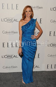 Actress Jayma Mays wears a pacific blue silk chiffon ruffled shoulder gown by Malandrino to the ELLE Women in Hollywood Tribute at the Four Seasons Hotel on Oct. 17, 2011.