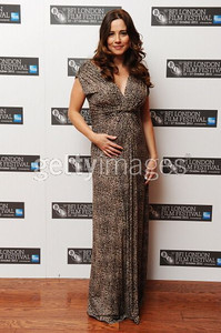 """Actress Linda Cardellini wears a short sleeve V-neck leopard print dress by Alberto Makali to the premiere of her film """"The Return"""" at the London Film Festival on Oct. 19, 2011."""