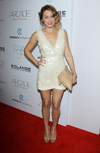 Lauren Conrad wears Hellmuth 18K rose gold croco bangles with diamonds to the Autumn Party benefit for the Children's Institute in West Hollywood on Oct. 26, 2011.