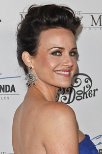 """Actress Carla Gugino wears Sutra 18K white gold chandelier earrings with rough diamonds to the premiere of her film """"The Mighty Macs"""" at the Arclight Hollywood on Oct. 20, 2011."""