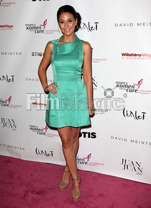 Actress Emmanuelle Chriqui wears a sea glass green cotton pique A-line cocktail dress with folded neckline from the David Meister Signature collection to the Designs for the Cure gala at the Bel-Air Bay Club in Pacific Palisades on Oct. 28, 2011.