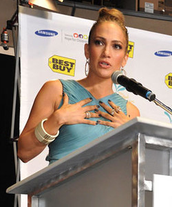 Jennifer Lopez wears Brumani Looping Shine 18K white and pink gold earrings with diamonds and champagne topaz, a matching Brumani ring and Isharya Vendome Lily bangles to the Samsung and Best Buy event for the Maribel Foundation in West Los Angeles on Oct. 25, 2011.