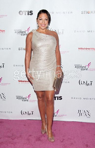 Actress Sara Ramirez wears a platinum Grecian-style one-shoulder cocktail dress with beaded shoulder accent by David Meister to the Designs for the Cure gala at the Bel-Air Bay Club in Pacific Palisades on Oct. 28, 2011.