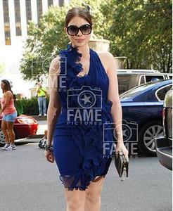 Actress Michelle Trachtenberg wear Swarovski's Amazing sunglasses in black in New York City.