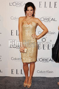 Actress Jenna Dewan wears a gold sequin cocktail dress with satin strap and criss-cross details by Edition by Georges Chakra to the ELLE Women in Hollywood Tribute at the Four Seasons Hotel on Oct. 17, 2011. Dewan accessorizes with Swarovski's metallic light gold crystal Poison ring and a gold crystal Beverly Hills clutch.
