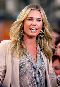 """Actress Rebecca Romijn wears Brumani Looping Shine Casual earrings in white and pink gold with diamonds and crystal and a Brumani Baobab Casual necklace in 18K white and pink gold with diamonds and white moonstone for her appearance on """"Extra"""" at The Grove on Oct. 27, 2011."""