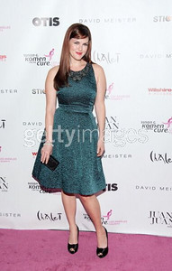Actress Sara Rue wears a teal textured A-line party dress with jeweled neckline from the David Meister Signature collection to the Designs for the Cure gala at the Bel-Air Bay Club in Pacific Palisades on Oct. 28, 2011.