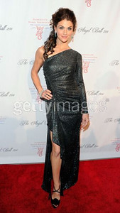 Samantha Harris wears David Meister's charcoal metallic knit one-sleeve gown with a thigh-high slit to the Angel Ball in New York on Oct. 17, 2011.