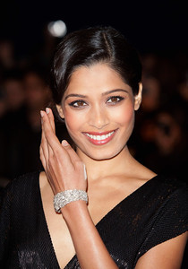 """Actress Freida Pinto wears a diamond cuff bracelet set in platinum from Chopard's Red Carpet Collection to the premiere of her film """"Trishna"""" in London on Oct. 22, 2011."""
