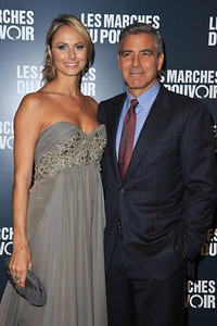 """Stacy Keibler, on the arm of actor George Clooney, wears Amrapali 14K gold Victorian diamond earrings and a Le Vian 18K white gold diamond ring to premiere of """"The Descendants"""" in Paris on Oct. 18, 2011."""