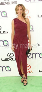 Actress Kim Raver wears a green and yellow statement ring by Daniel Swarovski and carries a black satin long Fan clutch at the 2011 Environmental Media Awards at Warner Bros. Studios on Oct. 15, 2011.