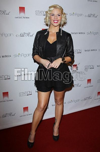 Singer Kimberly Caldwell wears a Petra black linen halter shorts romper and Fear black snake-skin leather jacket by Nikki Rich by WTB to the Rock Fashion fundraiser in Hollywood on Oct. 5, 2011.