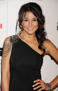 Actress Emmanuelle Chriqui wears an Amrapali 18K white gold snake bracelet with diamonds and rubies to the American Cinematheque Awards at the Beverly Hilton Hotel on Oct. 14, 2011.