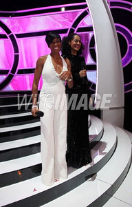 Actress Regina King wears Pamella Roland's white beaded jumpsuit with crystal encrusted halter neckline onstage at Black Girls Rock! in New York on Oct. 15, 2011. BET will broadcast the show Nov. 6.