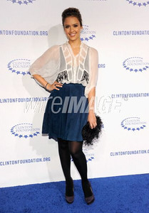 Actress Jessica Alba wears a Dior navy suede skirt and white silk chiffon blouse with black embroidery to the Clinton Foundation's Decade of Difference gala at the Hollywood Palladium on Oct. 14, 2011.