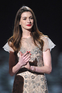 Actress Anne Hathaway wears a Hellmuth jewelry including an 18K white gold croco pattern star ring with diamonds, an 18K white gold croco pattern bangle and an 18K white gold diamond bangle onstage at Spike TV's SCREAM 2011 awards at the Universal Studios Backlot on Oct. 15, 2011.