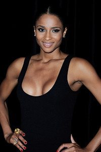Singer Ciara wears a Carrera y Carrera 18K gold and smoky quartz tiger ring and a Hellmuth gold and diamond dragonfly ring to the Paris Fashion Week Givenchy show on Oct. 2, 2011.