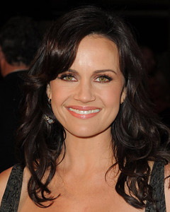 """Actress Carla Gugino wearing an Brumani jewelry including Baobab Casual earrings in 18k white and pink gold with diamonds and white moonstone; a Looping Shine bracelet in white and pink gold with diamonds and champagne topaz; and a Looping Shine Casual ring in white and pink gold with diamonds and crystal to the premiere of """"American Horror Story"""" ArcLight Cinerama Dome on Oct, 3, 2011."""
