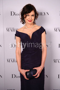 """Actress Elizabeth McGovern wears a navy Dior off the shoulder dress to the premiere of """"My Week With Marilyn"""" at the New York Film Festival on Oct. 9, 2011."""