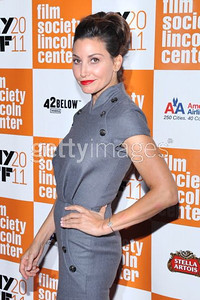 """Actress Gina Gershon wears a Dior gray wool dress to the premiere of """"My Week With Marilyn"""" at the New York Film Festival on Oct. 9, 2011."""
