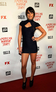 """Actress Lea Michele wears Amrapali 14K gold and diamond earrings and two M.C.L By Matthew Campbell Laurenza sapphire rings to the premiere of """"American Horror Story"""" ArcLight Cinerama Dome on Oct. 3, 2011."""