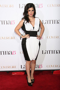 Actress Janelle Ortiz wears a GHADAH Paris silk dress with black waistband and side paneling to Latina Magazine's celebration at the Globe Theatre in Universal City on Oct. 5, 2011. Ortiz accessorizes with earrings and a bracelet by M.C.L by Matthew Campbell Laurenza.