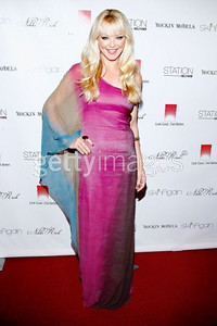 Actress Charlotte Ross wears a Luxe rainbow ombre chiffon one-shoulder caftan gown by Nikki Rich by WTB to the Rock Fashion fundraiser in Hollywood on Oct. 5, 2011.