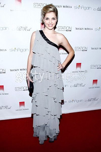 Actress Jen Lilley wears a Supernova gray chiffon tiered one-shoulder evening gown by Nikki Rich by WTB to the Rock Fashion fundraiser in Hollywood on Oct. 5, 2011.