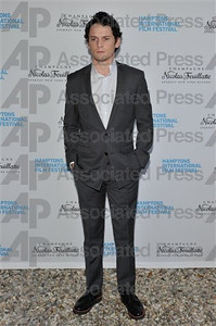 """Actor Anton Yelchin wears a gray Dior Homme wool suit and a Dior button-down shirt to the Hampton's Film Festival premiere of his film """"Like Crazy"""" on Oct. 16, 2011."""