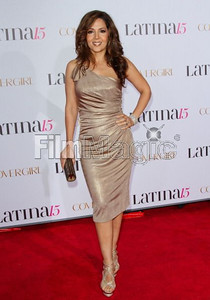 Maria Canals-Barrera wears David Meister's metallic gold jersey one-shoulder cocktail dress to Latina Magazine's celebration at the Globe Theatre in Universal City on Oct. 5, 2011. Canals-Barrera carries Swarovski's bronze crystal Power clutch.